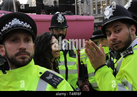London, City of London, UK. 17th Apr, 2019. Protester seen speaking to the police next to a giant pink boat parked in Oxford Street during the demonstration.Protesters blocked roads demanding for the Government to take action on climate change issues during the Extinction Rebellion disruption and protests in Central London. Credit: Ben Booth/SOPA Images/ZUMA Wire/Alamy Live News - Stock Photo
