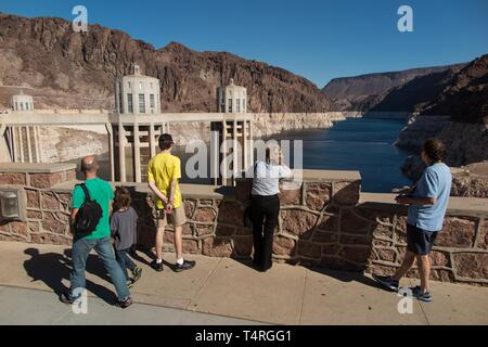 Boulder City, Nevada, USA. 23rd Oct, 2015. Tourists view the low waters of Lake Mead seen from the Hoover Dam. Years of unrelenting drought are straining a large reservoir of water between Nevada and Arizona. Lake Mead's water level has dropped by about 120 feet (37 meters) from where the water reached 15 years ago, on July 6, 2000. Lake Mead is no stranger to droughts. The man-made lake hit lower-than-average water levels in the mid-1950s and mid-1960s, and the current depletion is part of a decade-long trend. Lake Mead's current low level hasn't been recorded since the 1930s, when the lake - Stock Photo