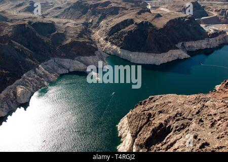 Boulder City, Nevada, USA. 23rd Oct, 2015. Low waters of Lake Mead seen from above in this aerial view via helicopter. Years of unrelenting drought are straining a large reservoir of water between Nevada and Arizona. Lake Mead's water level has dropped by about 120 feet (37 meters) from where the water reached 15 years ago, on July 6, 2000. Lake Mead is no stranger to droughts. The man-made lake hit lower-than-average water levels in the mid-1950s and mid-1960s, and the current depletion is part of a decade-long trend. Lake Mead's current low level hasn't been recorded since the 1930s, when t - Stock Photo