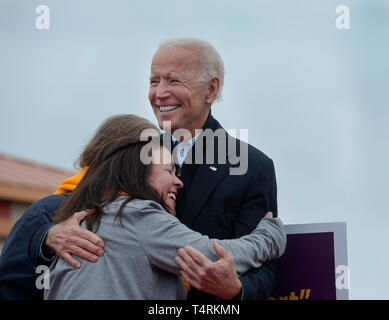 Dorchester, Massachusetts, USA. 18th April, 2019.  Former U.S. vice president and possible 2020 Democratic presidential candidate, Joe Biden, receives a hug from Yvonne Bento, a Striking Stop & Shop employee after Biden spoke to over 1000 striking Stop & Shop workers outside Boston area Stop & Shop grocery Store. Credit: Chuck Nacke/Alamy Live News - Stock Photo