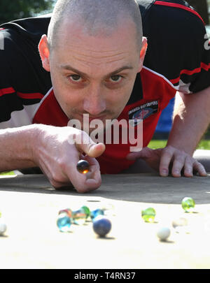 Crawley Sussex, UK. 19th Apr, 2019. Lloyd Evans from the Swansea Bay Packers competing in the World Marbles Championship held at The Greyhound pub at Tinsley Green near Crawley in Sussex . The annual event has been held on Good Friday every year since the 1930s and is open to players from around the world Credit: Simon Dack/Alamy Live News - Stock Photo