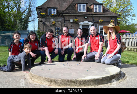 Crawley Sussex, UK. 19th Apr, 2019. The Swansea Bay Packers team at the World Marbles Championship held at The Greyhound pub at Tinsley Green near Crawley in Sussex . The annual event has been held on Good Friday every year since the 1930s and is open to players from around the world Credit: Simon Dack/Alamy Live News - Stock Photo