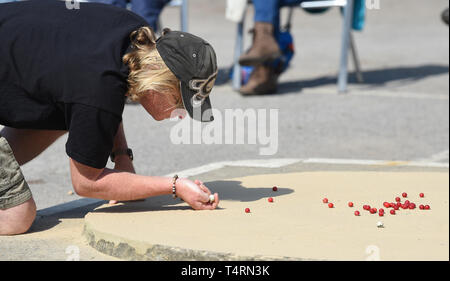 Crawley Sussex, UK. 19th Apr, 2019. Action in the hot sunny weather at the World Marbles Championship held at The Greyhound pub at Tinsley Green near Crawley in Sussex . The annual event has been held on Good Friday every year since the 1930s and is open to players from around the world Credit: Simon Dack/Alamy Live News - Stock Photo