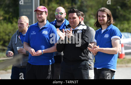 Crawley Sussex, UK. 19th Apr, 2019. Teams enjoy the hot weather and action at the World Marbles Championship held at The Greyhound pub at Tinsley Green near Crawley in Sussex . The annual event has been held on Good Friday every year since the 1930s and is open to players from around the world Credit: Simon Dack/Alamy Live News - Stock Photo