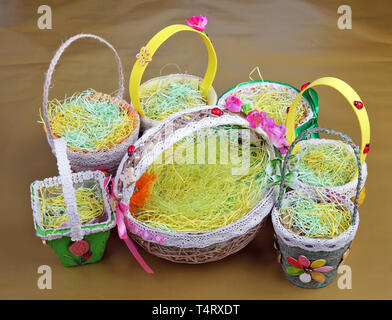 Easter handmade nest and  baskets made from  rope,  paper  and vegetables seeds. Spring homemade works concept - Stock Photo