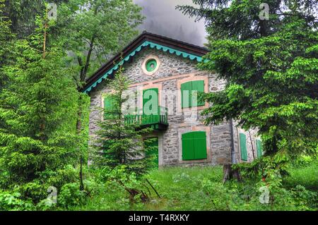 Rustic House in the Green Forest in Ticino, Switzerland. - Stock Photo