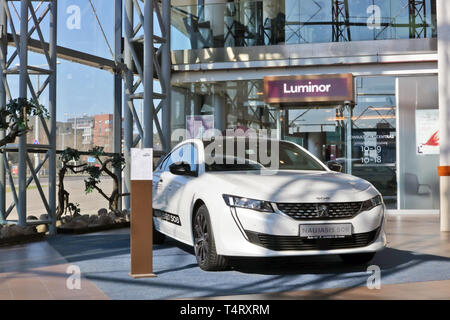 VILNIUS, LITHUANIA - APRIL 13, 2019:  Demonstration of new car  model  Peugeot 508  in the largest shopping center Panorama near the Luminor bank. Sun - Stock Photo