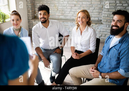 Happy creative team in office. Business, startup, design, people and teamwork concept - Stock Photo