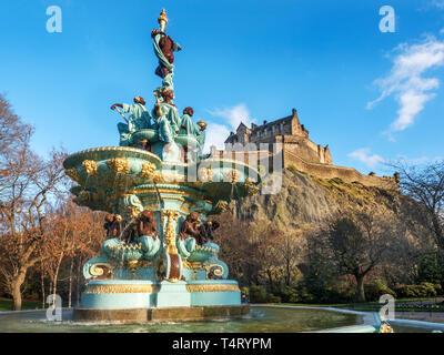 The Ross Fountain and Edinburgh Castle from West Princes Street Gardens Edinburgh Scotland - Stock Photo