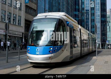 A West Midlands Metro tram in Birmingham city centre, England, UK - Stock Photo