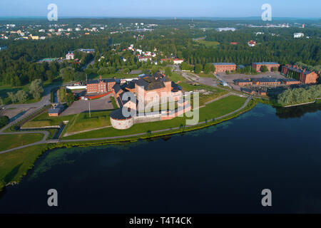 The ancient  Hameenlinna fortress  on the shore of Vanajavesi lake on a July morning (aerial photography). Finland - Stock Photo