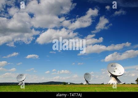 Parabolic antennas of earth station, near Raisting, Upper Bavaria, Germany, Europe - Stock Photo