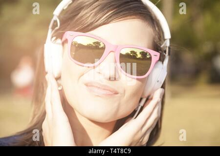Young woman listening to music, Germany - Stock Photo