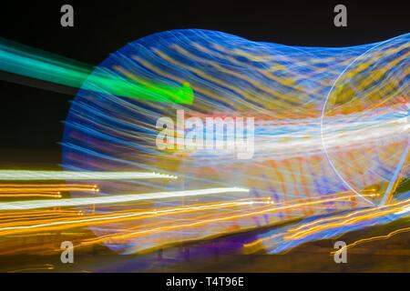 Ferris Wheel in Motion in Nice, Provence-Alpes-Côte d'Azur, France. - Stock Photo