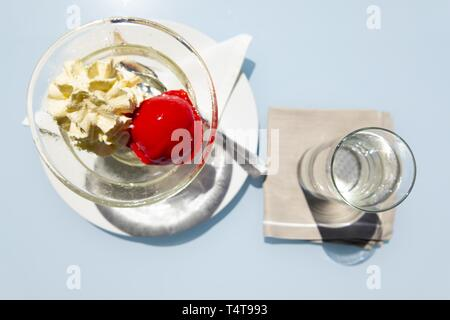 Ice Cream and Glass of Water - Stock Photo