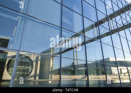 Government district on the river Spree, Marie-Elisabeth-Lueders-Haus and bridge reflected in a building, Berlin, Germany, Europe - Stock Photo