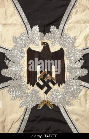 A troop flag of the infantry Made entirely of white silk with silver fringe on three sides. With a white disc on both sides, bordered by a silver-embroidered oak leaf wreath with central brown army eagle, in the background an Iron Cross of black silk, bordered in silver. The corners with black swastikas, bordered in silver. Colour-fresh, the pole-sleeve with traces of nails, barely noticeable stains. Dimensions circa 120 x 120 cm. In family possessions since the end of the war. historic, historical, infantry, military, armed forces, militaria, ob, Additional-Rights-Clearance-Info-Not-Available - Stock Photo