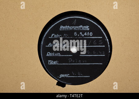 Korvettenkapitän Günther Prien - seven wax records from the German Radio Broadcasting Corporation (Reichsrundfunk) with interviews after the attack on Scapa Flow in 1939, Five double-sided and two one-sided records with interviews from the years 1939/40, all labelled 'Reichsrundfunk', 'Auftr.Nr.', 'Datum' each of the year of minting 1942, with inscriptions 'Prien' or 'Kptlt. Prien'. Optically well-preserved. In slightly damaged paper covers with punched linen margin for filing. Rare audio documents, reissued in 1942 for propaganda purposes to uphold the myth of the Scapa Fl, Editorial-Use-Only - Stock Photo