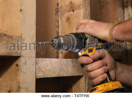 Embargoed to 0001 Friday April 19 Undated file photo of a man drilling. DIY-lovers are being urged to take care this bank holiday weekend as new figures show a rise in accidents caused by power tools. - Stock Photo