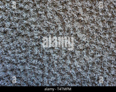Porous rock wall with black mineral, background - texture - Stock Photo