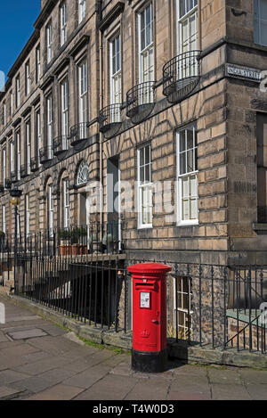 Red post box on Heriot Row in Edinburgh's New Town. - Stock Photo