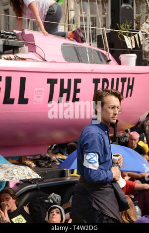 Extinction Rebellion rebel in Central London, bringing the centre of the city to a halt on 19th April 2019. - Stock Photo