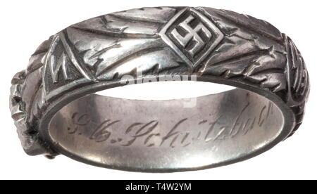 A SS deathïs head ring, custom-made by the jeweller Gahr in Munich, soldered underneath the separately applied deathïs head, the inside surface with engraved dedication 'S.lb. Schützbach 21.12.43 H. Himmler'. Weight 12.8 grammes, inside diameter 21 mm. historic, historical, 20th century, 1930s, 1940s, Waffen-SS, armed division of the SS, armed service, armed services, NS, National Socialism, Nazism, Third Reich, German Reich, Germany, military, militaria, utensil, piece of equipment, utensils, object, objects, stills, clipping, clippings, cut out, cut-out, cut-outs, fascism, Editorial-Use-Only - Stock Photo