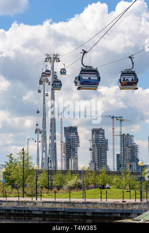 London, UK - May 1, 2018: Gondolas of Emirates Air Line depart from station at Royal Victoria Dock in eastern London - Stock Photo