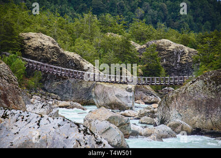 Hanging bridge at the Queulat National Park, Patagonia, Aysen, Chile - Stock Photo