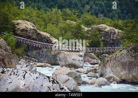 Hanging bridge at the Queulat National Park, Patagonia, Aysen, Chile - Stock Photo