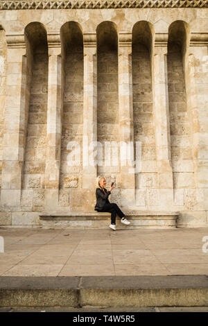 Blond woman taking selfie at Fisherman's Bastion - Stock Photo