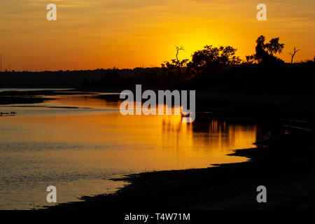 Sunset over the River Chobe on a summer evening in Botswana - Stock Photo