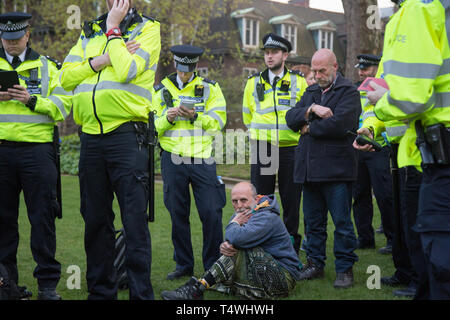 London UK 17th Apr 2019. Police officers arrest protesters near Parliament Square during fourth  day of protests by the Extinction Rebellion group. - Stock Photo