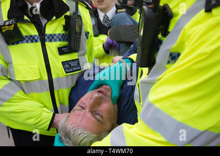 London UK 17th Apr 2019. Police officers arrest a protester in Parliament Square during the 3rd day of protests by the Extinction Rebellion group. - Stock Photo