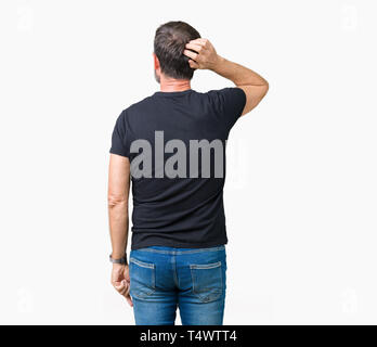 Handsome middle age hoary senior man over isolated background Backwards thinking about doubt with hand on head