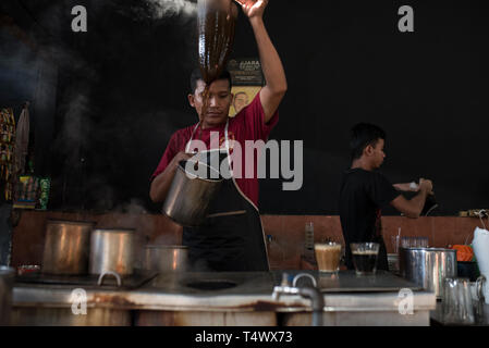 Traditional process of Aceh coffee - Stock Photo