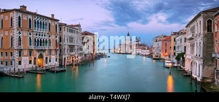 Venice, Italy. Panoramic cityscape image of Grand Canal in Venice, with Santa Maria della Salute Basilica in the background, during sunset - Stock Photo