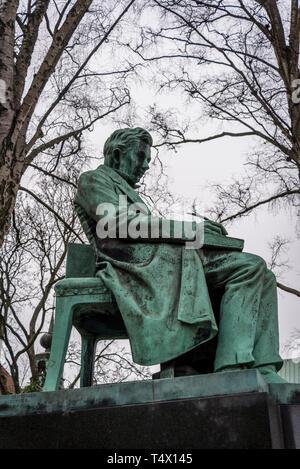 Statue of Soren Kierkegaard in the garden of the Royal Danish Library old building on Slotsholmen in central Copenhagen, Denmark - Stock Photo