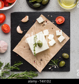 Block of butter and spices on board - Stock Photo