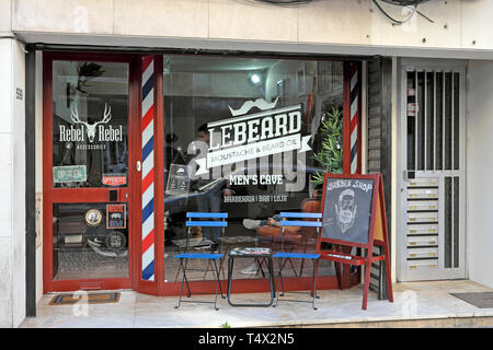 Barber Shop LeBeard outside view of hipster storefront and window graphics signs on Rua de Cedofeita in Porto Portugal Europe  KATHY DEWITT - Stock Photo