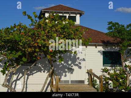 A secondary building to the historical Port Boca Grande Lighthouse Museum complex, surrounded by seagrape trees, built in 1890 in Boca Grande, FL - Stock Photo