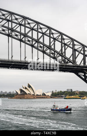 Sydney Harbour Bridge carries car, train, bicycle and pedestrian traffic between Sydney Central Business District (CBD) and the North Shore. - Stock Photo