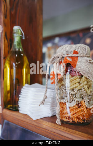 Cereal pots and breakfast bowls in a hotel on wooden board - Stock Photo