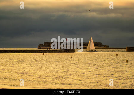 Cherbourg-Octeville, France - August 21, 2018: Sailboat in the harbor of Cherbourg during sunset. Normandy, France - Stock Photo