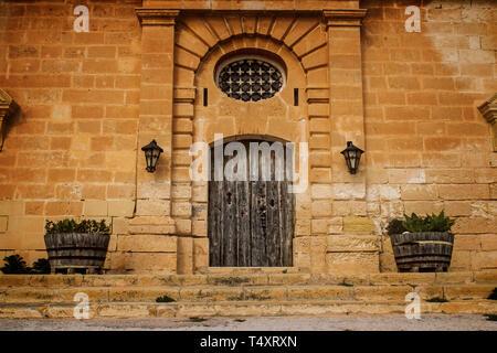 Old Baroque Door. A symmetrical Old Baroque Door located in Selmun, Malta - Stock Photo