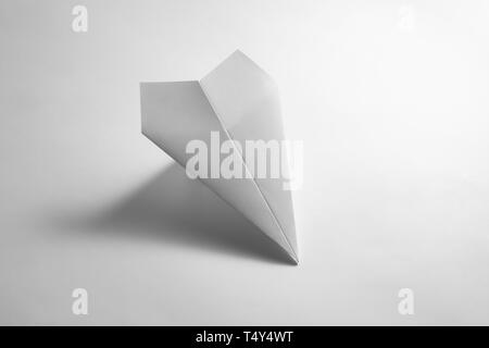 paper airplane on pastel background. Minimal flat lay school concept. - Stock Photo