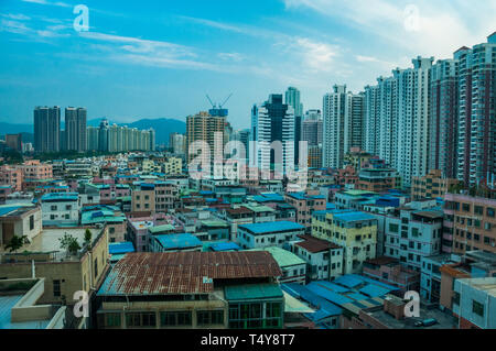 View of housing in Futian District, Shenzhen from Gangxia North looking south towards the hills of Hong Kong. - Stock Photo
