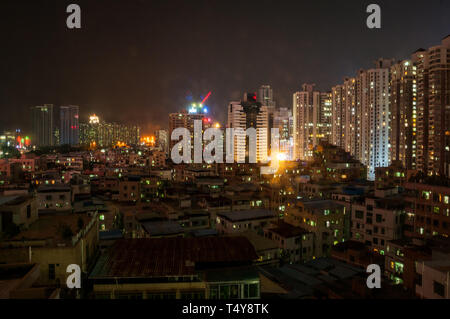 Night view of the housing in Futian District, Shenzhen looking towards the border with Hong Kong. - Stock Photo