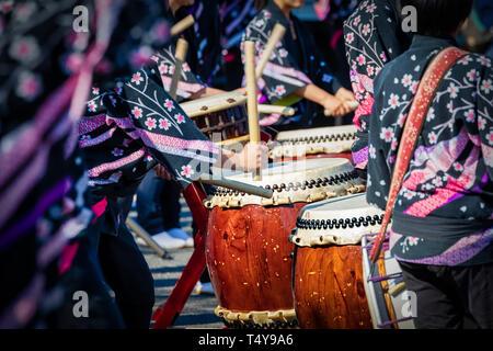 Musicians performing on Taiko Drums in Narita, Japan. - Stock Photo