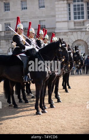 London, United Kingdom - 14th April 2019. Queen's Guard March on Horses in the Streets of London, Saint James park - Stock Photo